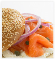 Photo of a delicious smoked salmon and cream cheese bagel.