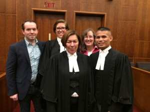 Photo of lawyers and clients in the TWU case