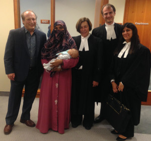 Photo of lawyers and client at the Federal Court of Appeal.