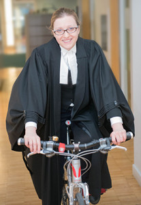 Photo of an associate lawyer on her bicycle.